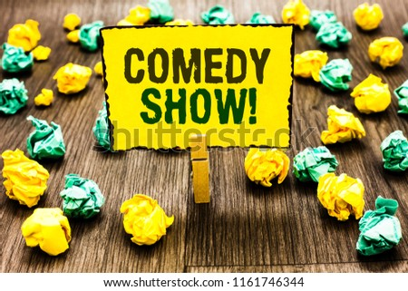Writing note showing Comedy Show. Business photo showcasing Funny program Humorous Amusing medium of Entertainment Clothespin holding yellow note paper crumpled papers several tries.