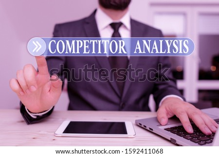 Writing note showing Competitor Analysis. Business photo showcasing assessment of the strengths and weaknesses of rival firm Male human wear formal clothes present use hitech smartphone.