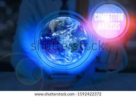 Writing note showing Competitor Analysis. Business photo showcasing assessment of the strengths and weaknesses of rival firm Elements of this image furnished by NASA.