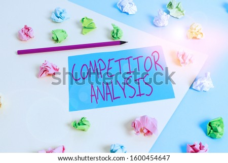 Writing note showing Competitor Analysis. Business photo showcasing assessment of the strengths and weaknesses of rival firm Colored crumpled papers empty reminder blue yellow clothespin.