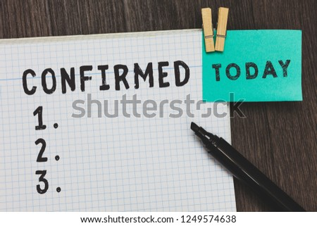 Writing note showing Confirmed. Business photo showcasing firmly established in particular habit belief or way of life Open notebook page pins holding reminder marker wooden background. #1249574638