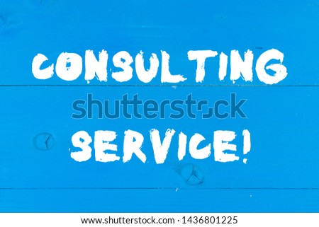 Writing note showing Consulting Service. Business photo showcasing Experts that offers knowledge to a third party for a fee Wooden texture old vintage background horizontal boards holes.