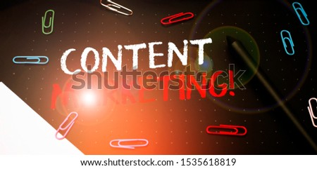 Writing note showing Content Marketing. Business photo showcasing involves creation and sharing of online material Scissors and writing equipments plus math book above textured backdrop. #1535618819