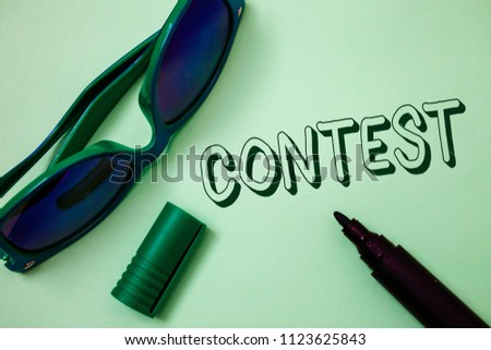 Writing note showing  Contest. Business photo showcasing Game Tournament Competition Event Trial Conquest Battle Struggle Ideas messages white background open marker sunglasses communicate. #1123625843