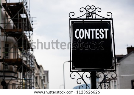 Writing note showing  Contest. Business photo showcasing Game Tournament Competition Event Trial Conquest Battle Struggle Vintage black board sky old city ideas scaffolding landscapes antique. #1123626626