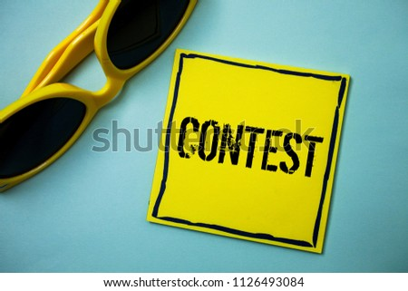 Writing note showing  Contest. Business photo showcasing Game Tournament Competition Event Trial Conquest Battle Struggle Ideas messages blue background sunglasses casual annotations thoughts. #1126493084