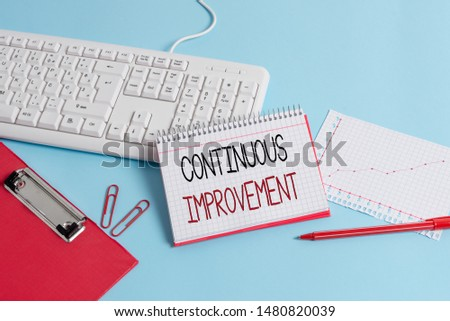 Writing note showing Continuous Improvement. Business photo showcasing ongoing effort to improve products or processes Paper blue keyboard office study notebook chart numbers memo.