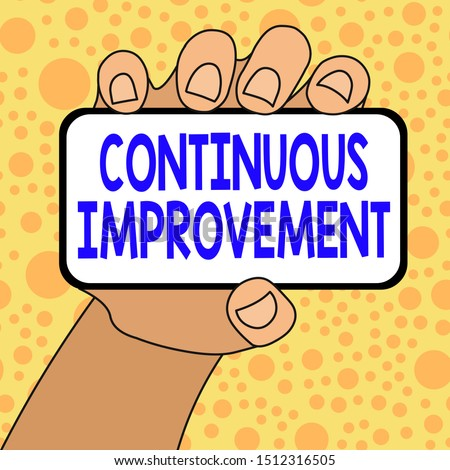 Writing note showing Continuous Improvement. Business photo showcasing ongoing effort to improve products or processes Closeup of Smartphone in Hand with Blank Screen and Text Space.
