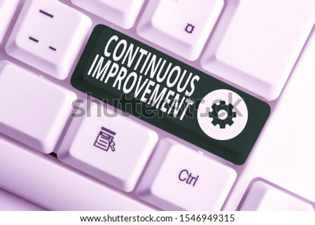 Writing note showing Continuous Improvement. Business photo showcasing ongoing effort to improve products or processes White pc keyboard with note paper above the white background.