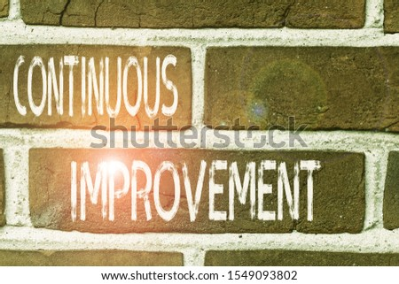 Writing note showing Continuous Improvement. Business photo showcasing ongoing effort to improve products or processes Front view red brick wall facade background Old grunge scenery.