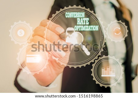 Writing note showing Conversion Rate Optimization. Business photo showcasing system for increasing percentage of visitors Woman wear formal work suit presenting presentation using smart device.