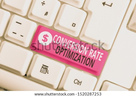 Writing note showing Conversion Rate Optimization. Business photo showcasing system for increasing percentage of visitors White pc keyboard with note paper above the white background.