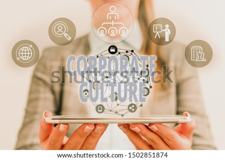 Writing note showing Corporate Culture. Business photo showcasing pervasive values and attitudes that characterize a company Female human wear formal work suit presenting smart device. #1502851874