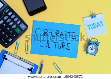 Writing note showing Corporate Culture. Business photo showcasing pervasive values and attitudes that characterize a company Clipboard sheet calculator pencil clock smartphone color background.