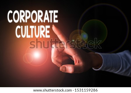 Writing note showing Corporate Culture. Business photo showcasing pervasive values and attitudes that characterize a company Finger pointing in the Dark with hand pointing in the copy space.