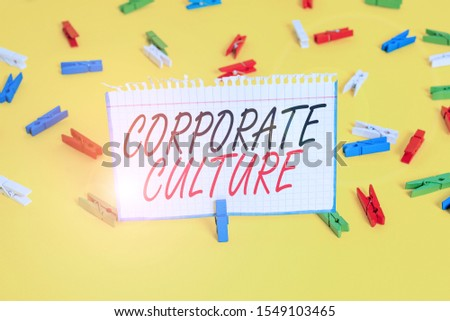 Writing note showing Corporate Culture. Business photo showcasing pervasive values and attitudes that characterize a company Colored clothespin papers empty reminder yellow floor background office.