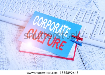 Writing note showing Corporate Culture. Business photo showcasing pervasive values and attitudes that characterize a company notebook reminder clothespin with pinned sheet light wooden.