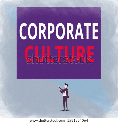 Writing note showing Corporate Culture. Business photo showcasing pervasive values and attitudes that characterize a company Isolated view man standing pointing upwards two hands big rectangle.