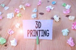 Writing note showing 3D Printing. Business photo showcasing making a physical object from a threedimensional digital model Colored crumpled papers wooden floor background clothespin.