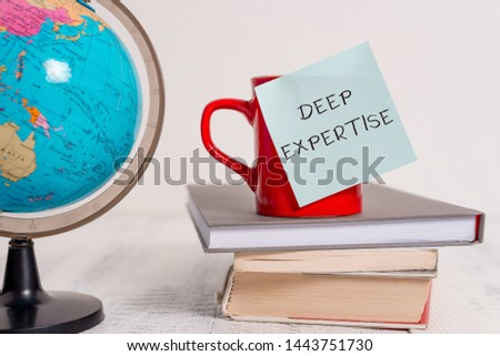 Writing note showing Deep Expertise. Business photo showcasing Great skill or broad knowledge in a particular field or hobby Globe map world earth cup blank sticky note stacked books wooden table. #1443751730