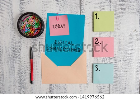 Writing note showing Digital Connections. Business photo showcasing Powerful Ways to Connect Online Global High Definition Envelope letter sticky note ballpoint clips on wooden background. #1419976562