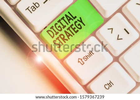 Writing note showing Digital Strategy. Business photo showcasing plan for maximizing the business benefits of data assets.