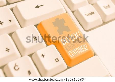 Writing note showing Do You Know Your Customer Question. Business photo showcasing service identify clients with relevant information White pc keyboard with note paper above the white background.