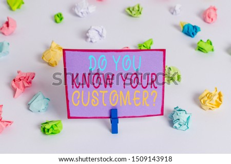Writing note showing Do You Know Your Customer Question. Business photo showcasing service identify clients with relevant information Colored crumpled paper empty reminder white floor clothespin.