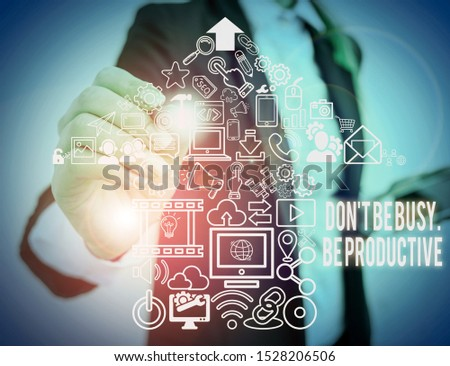 Writing note showing Don T Be Busy Be Productive. Business photo showcasing Work efficiently Organize your schedule time Woman wear formal work suit presenting presentation using smart device.