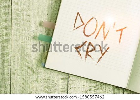 Writing note showing Don T Cry. Business photo showcasing Shed tears typically as an expression of distress pain or sorrow Notebook stationary placed above classic wooden backdrop. #1580557462