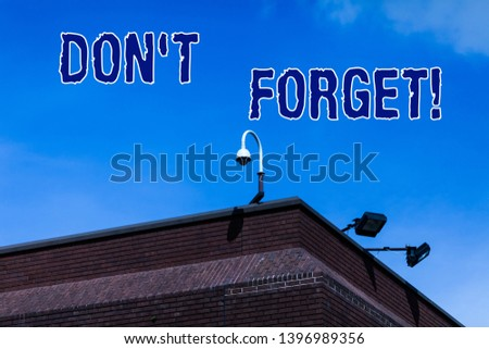 Writing note showing Don T Forget. Business photo showcasing used to remind someone about important fact or detail. #1396989356