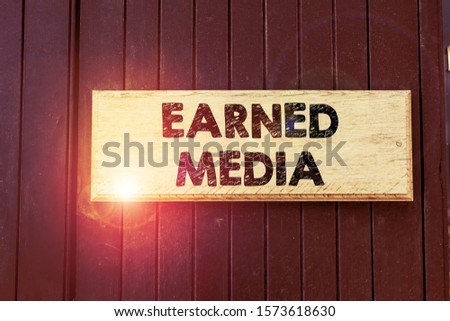 Writing note showing Earned Media. Business photo showcasing publicity gained through promotional efforts other than paid Empty white board for advertising. White space for text adding.