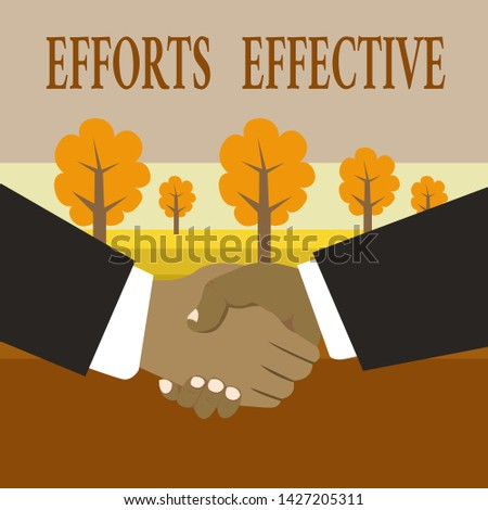 Writing note showing Efforts Effective. Business photo showcasing Produces the results as per desired Goal Target Achieve Hand Shake Multiracial Male Business Partners Formal Suits.