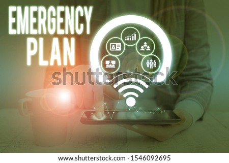 Writing note showing Emergency Plan. Business photo showcasing procedures for handling sudden or unexpected situations Picture photo network scheme with modern smart device.