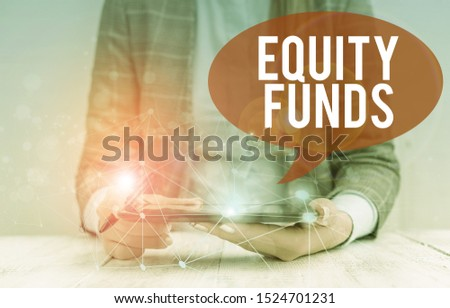 Writing note showing Equity Funds. Business photo showcasing type of mutual fund that buys ownership in businesses Female human wear formal work suit presenting smart device.