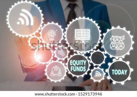 Writing note showing Equity Funds. Business photo showcasing type of mutual fund that buys ownership in businesses Male wear formal work suit presenting presentation smart device.