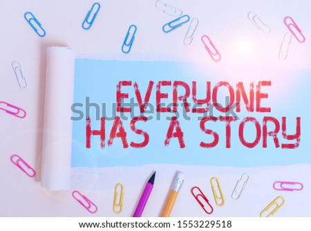 Writing note showing Everyone Has A Story. Business photo showcasing Background storytelling telling your memories tales Stationary and torn cardboard placed above plain pastel table backdrop. #1553229518
