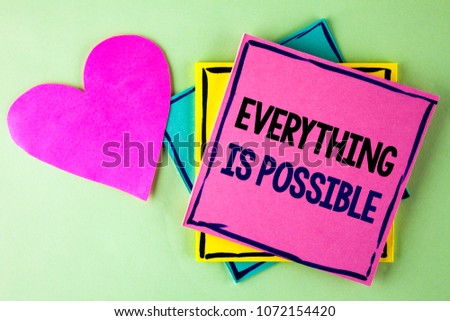 Writing note showing  Everything Is Possible. Business photo showcasing All you think or dream can become true Optimistic written Pink Sticky Note Paper plain background Heart next to it. #1072154420
