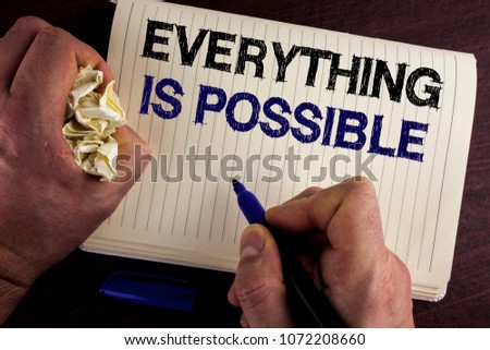 Writing note showing  Everything Is Possible. Business photo showcasing All you think or dream can become true Optimistic written by Man Notebook Book wooden background Pen Crumpled Paper #1072208660