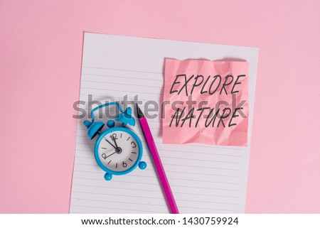 Writing note showing Explore Nature. Business photo showcasing Discovering the countryside Enjoying the wildlife Travel Striped paper sheet note pencil vintage alarm clock colored background. #1430759924