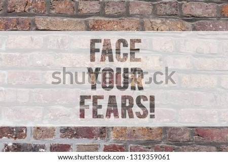 Writing note showing Face Your Fears. Business photo showcasing Have the courage to overcome anxiety be brave fearless Brick Wall art like Graffiti motivational call written on the wall. #1319359061