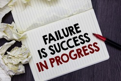 Writing note showing Failure Is Success In Progress. Business photo showcasing You have to make mistakes for improvement Marker over notebook crumpled papers pages several tries mistakes.