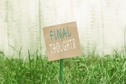 Writing note showing Final Thoughts. Business photo showcasing the conclusion or last few sentences within your conclusion Plain paper attached to stick and placed in the grassy land.