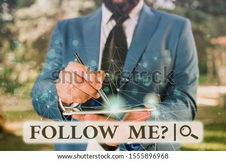 Writing note showing Follow Me Question. Business photo showcasing go or come after demonstrating or thing proceeding ahead Male human wear formal suit presenting using smart device. #1555896968
