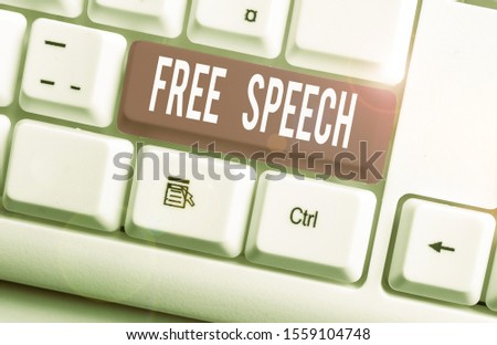 Writing note showing Free Speech. Business photo showcasing the right of showing to express their opinions publicly White pc keyboard with note paper above the white background.