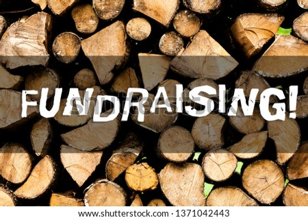 Writing note showing Fundraising. Business photo showcasing seeking to generate financial support for charity or cause Wooden background vintage wood wild message ideas intentions thoughts. #1371042443