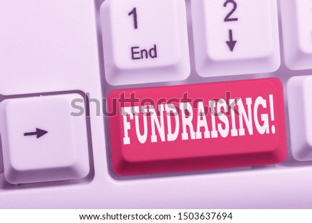 Writing note showing Fundraising. Business photo showcasing seeking to generate financial support for charity or cause White pc keyboard with note paper above the white background. #1503637694