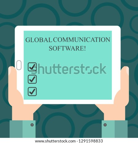 Writing note showing Global Communication Software. Business photo showcasing Ways to connect showing across geographic Hu analysis Hand Holding Tablet Smartphone Display Unit photo.