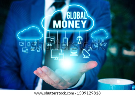 Writing note showing Global Money. Business photo showcasing International finance World currency Transacted globally Male wear formal work suit presenting presentation smart device. #1509129818