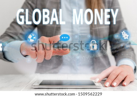 Writing note showing Global Money. Business photo showcasing International finance World currency Transacted globally Female human wear formal work suit presenting smart device. #1509562229